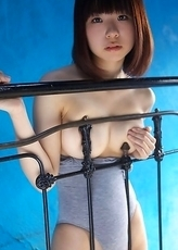 Hikari Azuma plays with bath suit on her generous boobs